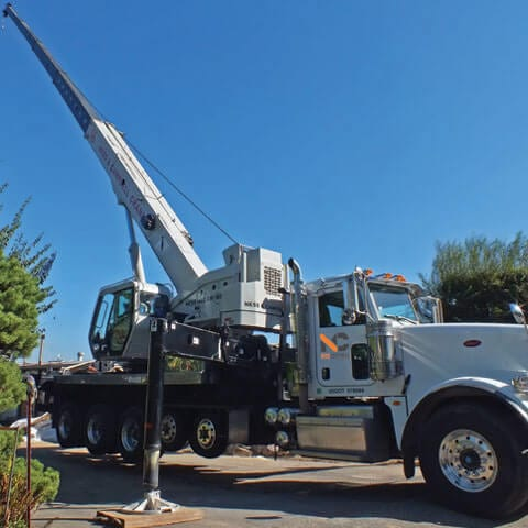 A boom truck used to do heavy equipment lifting.